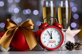 Red Alarm Clock And Champagne Goblet At Office Table In New Year Eve Closeup. Festive Mood Within An poster