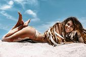 Cheerful Young Woman In Boho Style Bikini Lying On Sand At The Beach poster