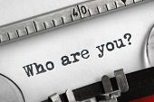 Who are you typed on an old typewriter concept for self belief, positive attitude and  identity poster