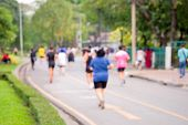 Rear View And Blurred Image Focus Of People Who Are Jogging In The Public Park In The Evening Time O poster
