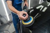 The Polisher Polishes The Body Of The Vehicle With Special Wax To Protect The Car From Minor Scratch poster
