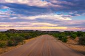 Sunset Over The Gravel Road C35 Going From The West Coast To Kamanjab In Damaraland, Namibia. poster