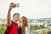Young Couple In Love Walking On A Street Of European City. Sightseeing Traveler Taking Selfie Photo poster