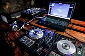 Dj Plays Live Set And Mixing Music On Turntable Console At Stage In The Night Club. Disc Jokey Hands poster