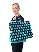 Senior Woman Posing With Dotted Shopping Bag