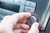 Driver Hand Tuning Temperature Control Knob In Car Air Conditioning System Close Up, Comfort And Fre poster