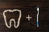 Dental Care With An Toothbrush. Teeth And Toothbrush On Wooden Background. Sound Teeth. Oral Hygiene poster