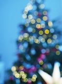 Christmas Tree With Defocused Lights And Star. poster