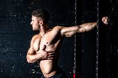 Muscles Stretching, Young Sweaty Muscular Strong Fit Man Stretching His Arm And Chest Muscles After  poster