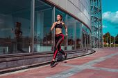 Beautiful Girl Athlete Running Morning Jog Summer City. Sportswear Leggings Top. Fitness, Youth Life poster
