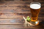 Mag With Beer, Spikelets And Hop On Wooden Table, Space For Text poster