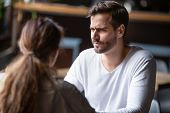 Doubting Dissatisfied Man Looking At Woman, Bad First Date Concept poster