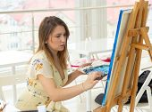 Art Class, Drawing And Creativity Concept - Female Student Sitting In Front Of Easel With Palette An poster