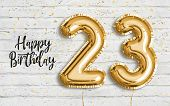 Happy 23 Th Birthday Gold Foil Balloon Greeting White Wall Background. 23 Years Anniversary Logo Tem poster
