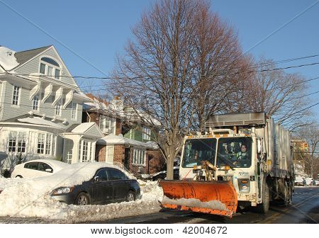 New York Department of Sanitation cleaning streets in Brooklyn, NY  after massiv