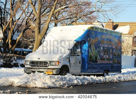 Truck under snow  in Brooklyn, NY after massive snowstorm