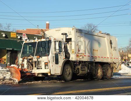 New York Department of Sanitation cleaning streets in Brooklyn, NYafter massiv