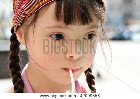 Portrait Of Little Girl Drinking Water