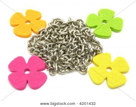 Flowers Of Felt Fraiming A Chain