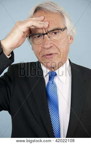 Worried businessman with problem or headache