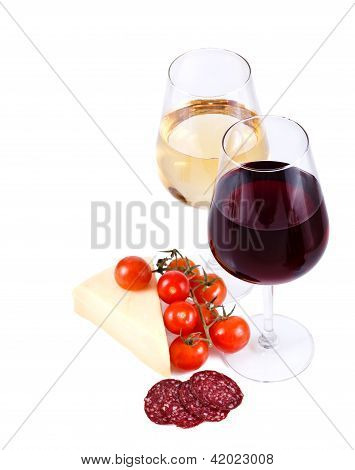 Two Wine Glasses With Red And White Wine, Cheese, Tomato And Sausage