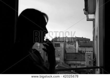 Female Silhouette By Window