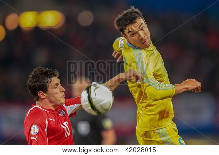 VIENNA,  AUSTRIA - OCTOBER 16: Zlatko Junuzovic (#10 Austria) and Kairat Nurdauletov (#6 Kazakhstan) fight for the ball during the WC qualifier soccer game on October 16, 2012 in Vienna, Austria.