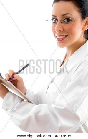 Side Pose Of Doctor With Writing Pad And Pen On White Background