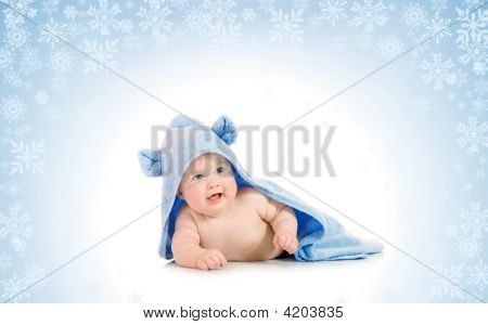 Small Smiling Baby With On Snowy Background