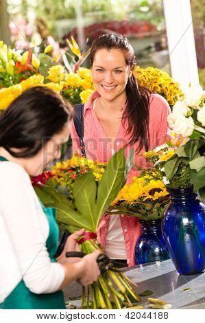 Cheerful woman buying bouquet flower shop florist cutting market