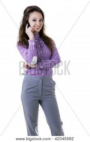 Smiling Businesswoman With A Cellphone In Her Hands Isolated On White