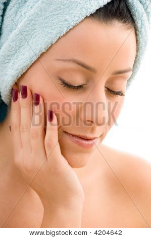 Front View Of Female Touching Her Face Against White Background