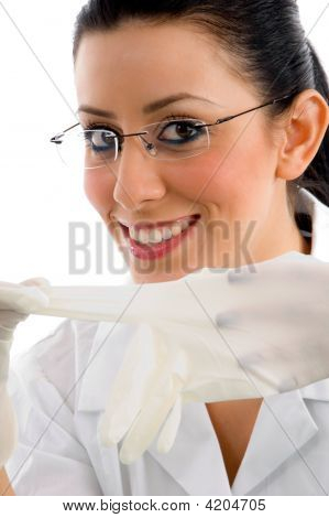 Close View Of Smiling Doctor Wearing Gloves And Eyewear On White Background