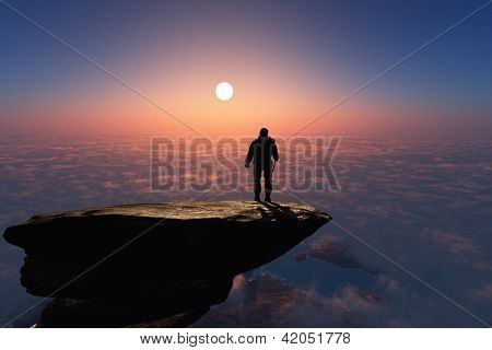 Silhouette of a man on a rock.