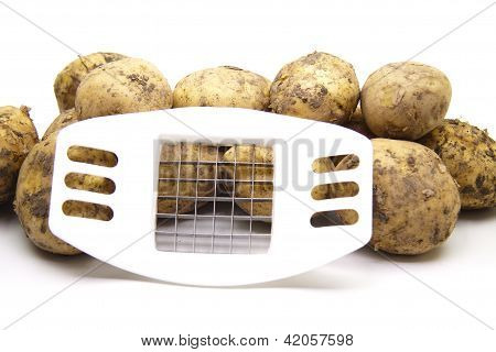 Fresh brown Potatos with French fry slicer