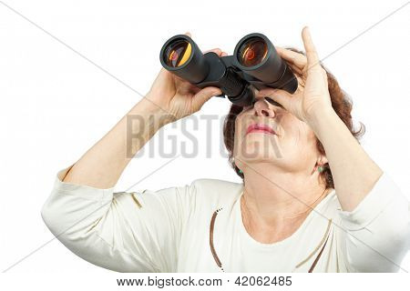 Elderly woman looks through binocular