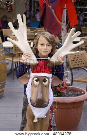 Girl And Christmas Reindeer