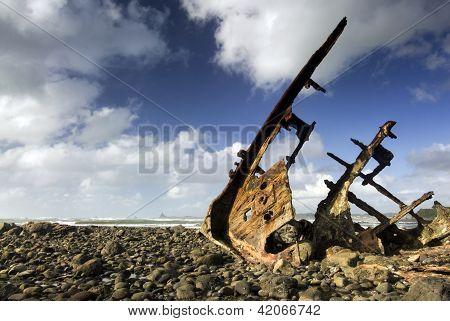 Shipwreck on rocky beach