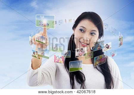 Beautiful Woman And Digital Contact