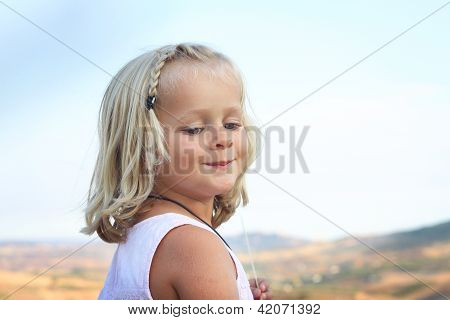 Child outside countryside