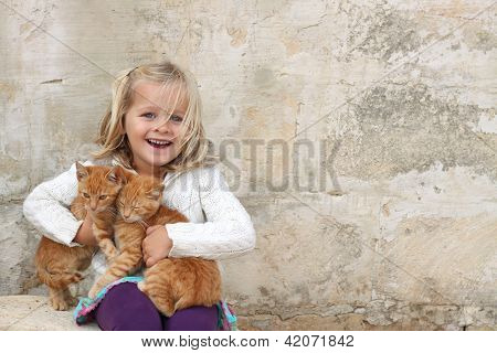 Cute Girl Holding Kittens