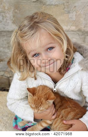 Smiling Child With Kitten