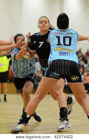 SIOFOK, HUNGARY - FEBRUARY 9: Vivien Lerant (black 7) in action at a Hungarian National Championship handball match Siofok KC (black) vs. Fehervar KC (blue) February 9, 2013 in Siofok, Hungary.