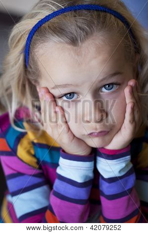 Sulky Little Girl With Head In Hands
