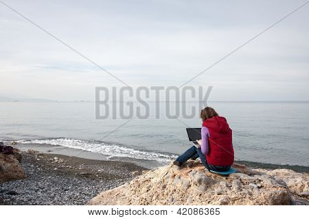 Woman Working At The Seaside