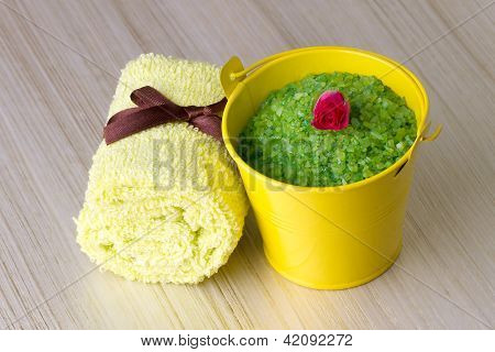 Small yellow bucket with a green sea salt
