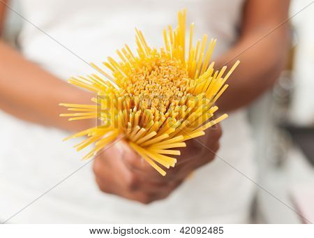 African American  Woman  In The Kitchen Holding Spaghetti
