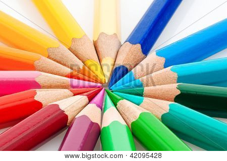 many different colored pencils on a white background.