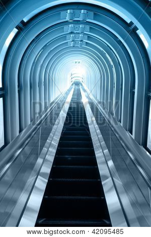 Contemporary blue moving escalator