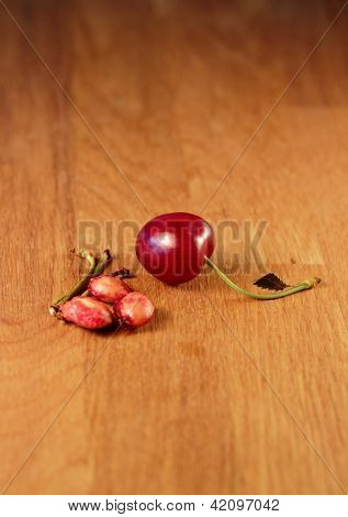 A cherry with pits and stems